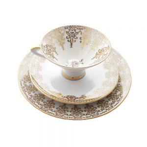 Bavaria trio fincan takımı Pastel; pasta tabağı & çay fincanı ve tabağından oluşan üçlü porselen set. Pastel tonlarla altın işlemeli kenarların uyumu! Retrozade - Vintage Retro Antika