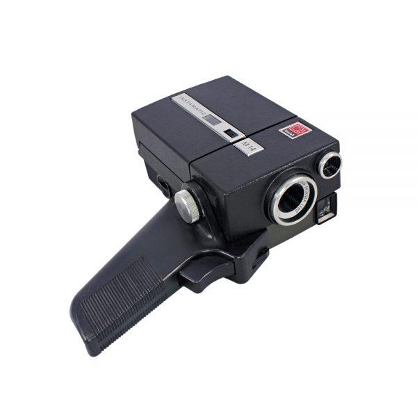1970'ler Amerika üretimi Orijinal tutma sapı, deri hard-case çantası ve kitapçığıyla, Ektanar 2.7/14mm optik lensli Kodak Instamatic M14 8mm film kamerası.